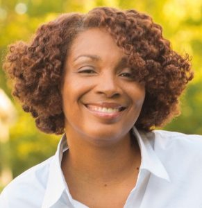 Headshot of Dr. Zsakeba Henderson, a Black woman, with a warm smile facing forward.